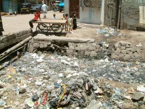 Kids playing next to a garbage-clogged drainage channel in a slum pocket in Bandra East